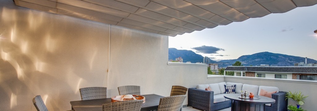 Retractable fabric canopies on condo terrace balconies.